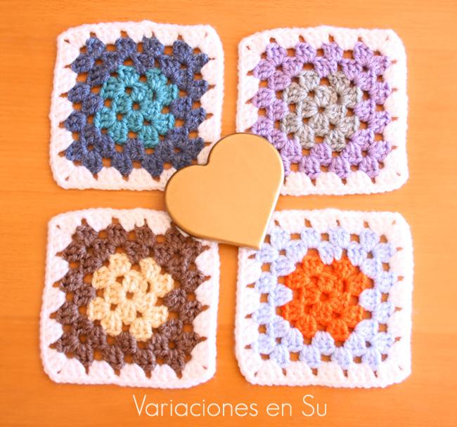 Granny squares o cuadrados de ganchillo tejidos en lana de varios colores.